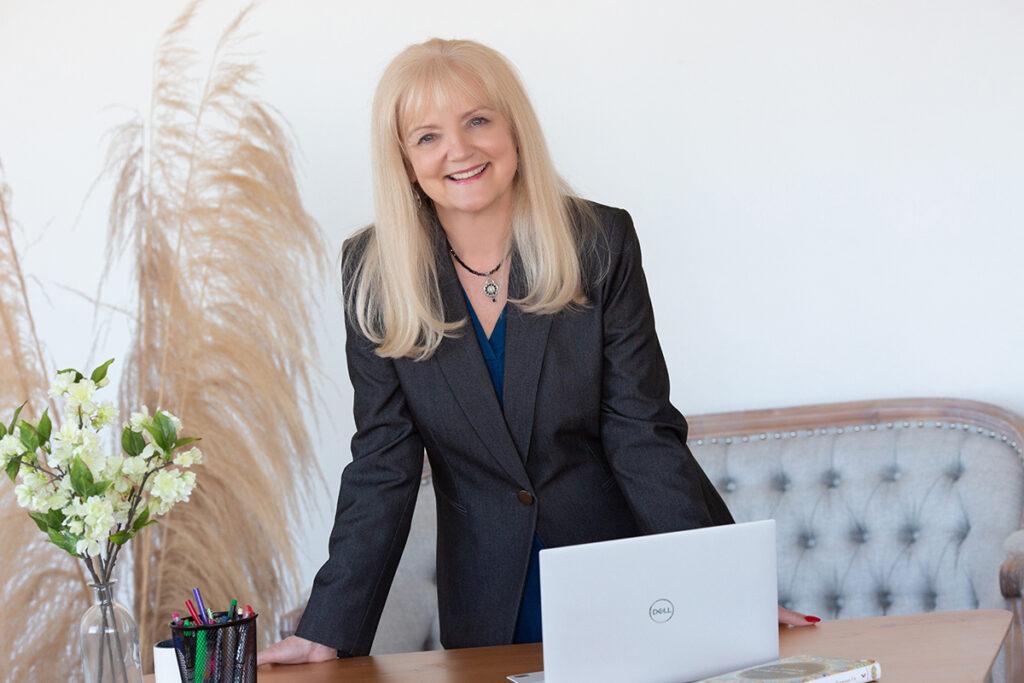 Denver branding headshot of a woman leaning over a desk