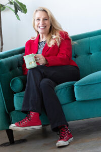 Personal branding image of a realtor with lace up tennies on a couch