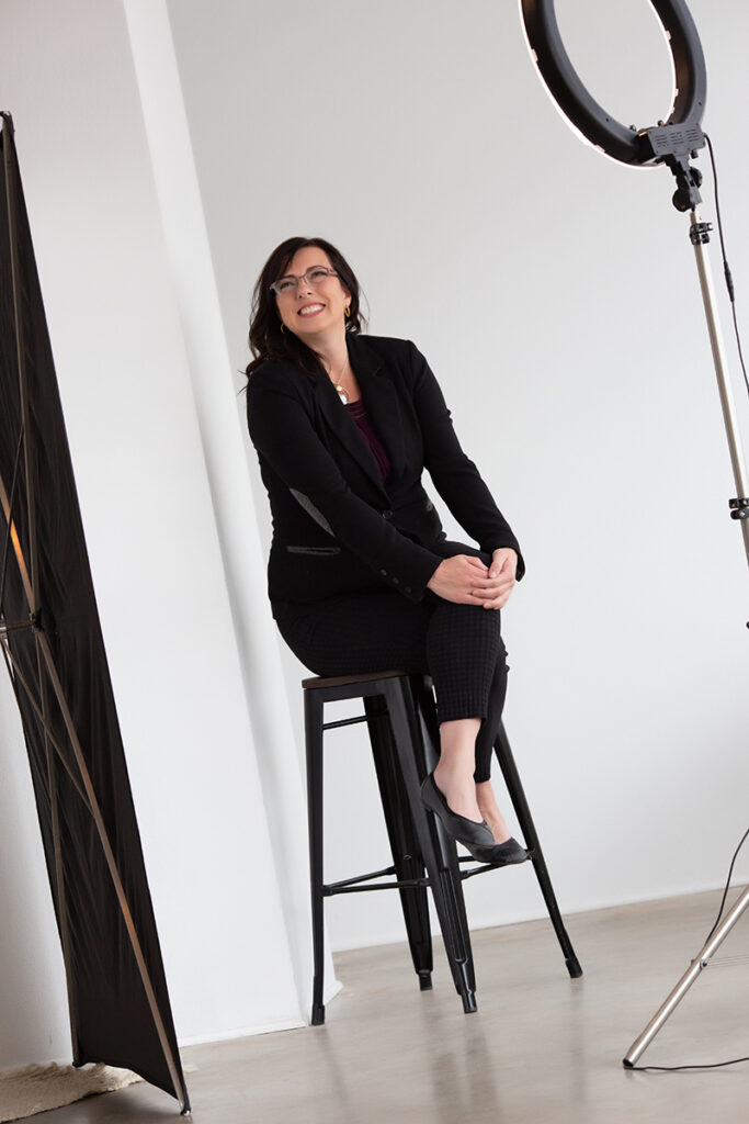 Personal branding photoshoot candid of a woman with studio lights