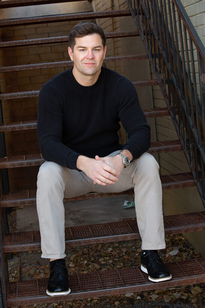 Denver dating profile image of a man on stairs