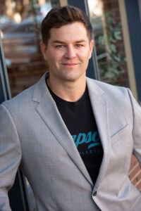 Denver dating profile image of guy with graphic t-shirt and jacket